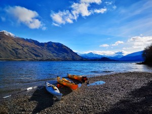 Three Kayaks on the lakeshore at Bremner Bay Wanaka