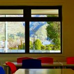 Dining area with a view towards green hills in the facility block at Wanaka Lakeview Holiday Park