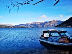 paddle wanaka boat on shore