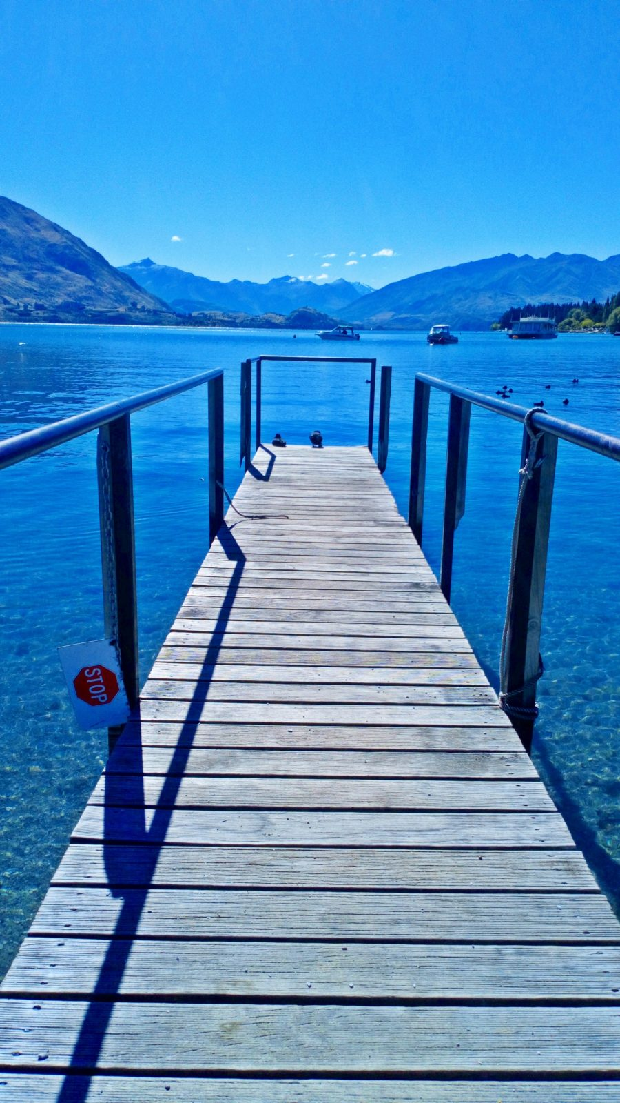 Blue Skies and blue lake at the jetty in Wanaka Town Centre